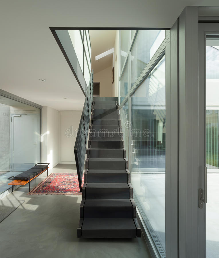 Hall with iron staircase. Interior, iron staircase of a modern house royalty free stock image