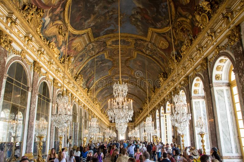 Hall of Mirrors. Famous hall of Mirrors full of tourists in Palace of Versailles, France