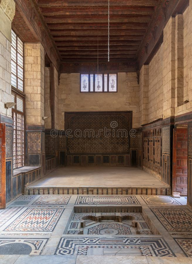 Hall at ottoman era historic house of Moustafa Gaafar Al Seleehdar, Cairo, Egypt with decorated ceiling and ornate marble floor stock image
