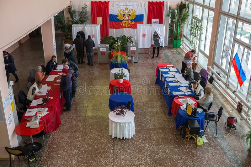 Hall for voting is decorated with colors of Russian flag. royalty free stock photography