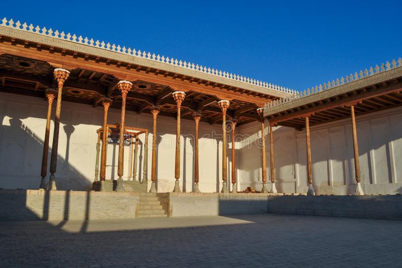 Hall with wooden columns of the ancient citadel in Bukhara `Ark citadel`. Hall with wooden columns of the ancient citadel in Bukhara `Ark citadel`, Uzbekistan royalty free stock photography