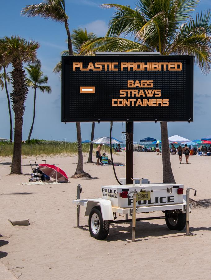 Mobile sign on beach saying that plastic bags, straws and containers are prohibited stock photography