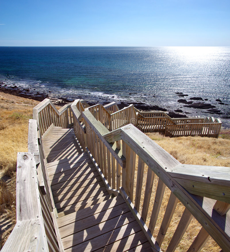 Hallett Cove Beach Steps. Wooden steps zigzagging down to the rocky beach at Hallett Cove. Adelaide, South Australia stock photography