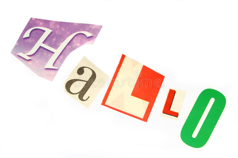 Hallo. A closeup photo of colorful magazine cuttings - a 'Hallo' word royalty free stock photos