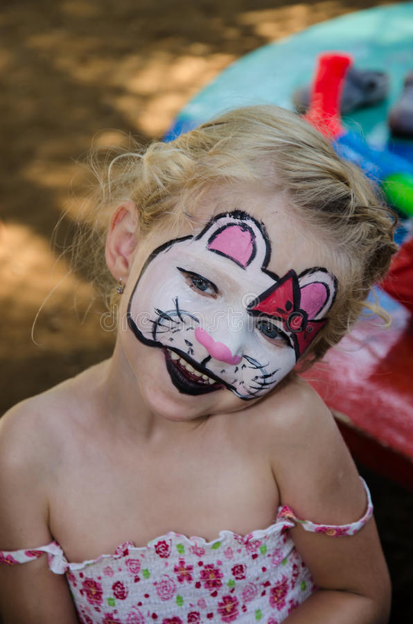 Hallo kitty face painting. Beautiful blond girl with cat face painting royalty free stock photography