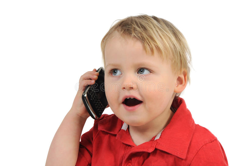 Hallo, mum. Little boy speaks on the phone, isolated on white royalty free stock photos