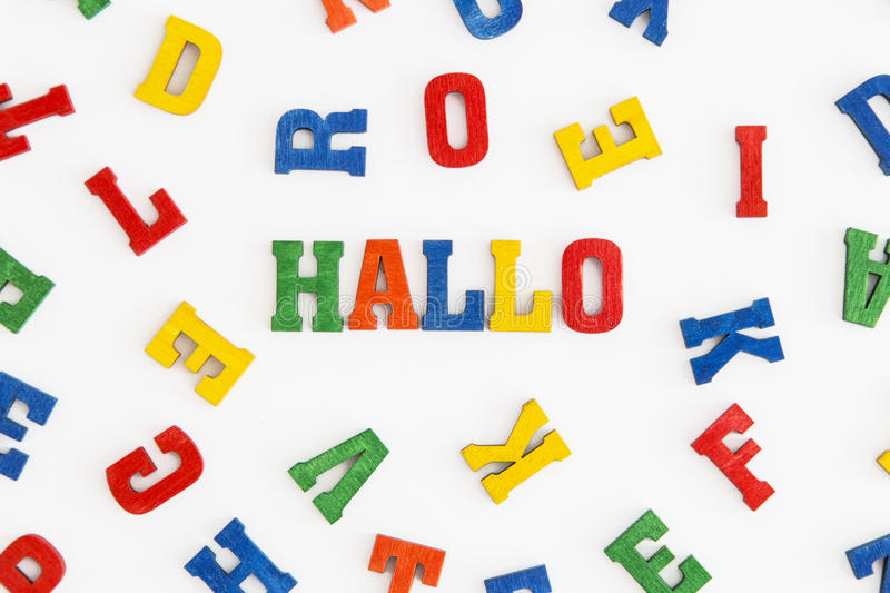 Hallo. Series Hello: word Hallo (hello in German) in wooden letters on white background stock photography