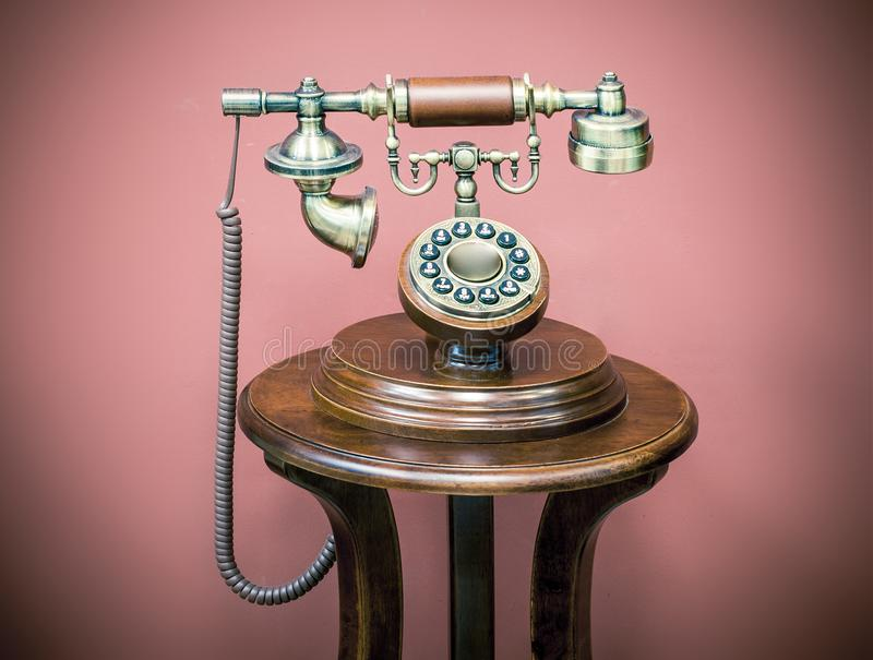 Hallo!. Stylized old telephone on its stand stock image