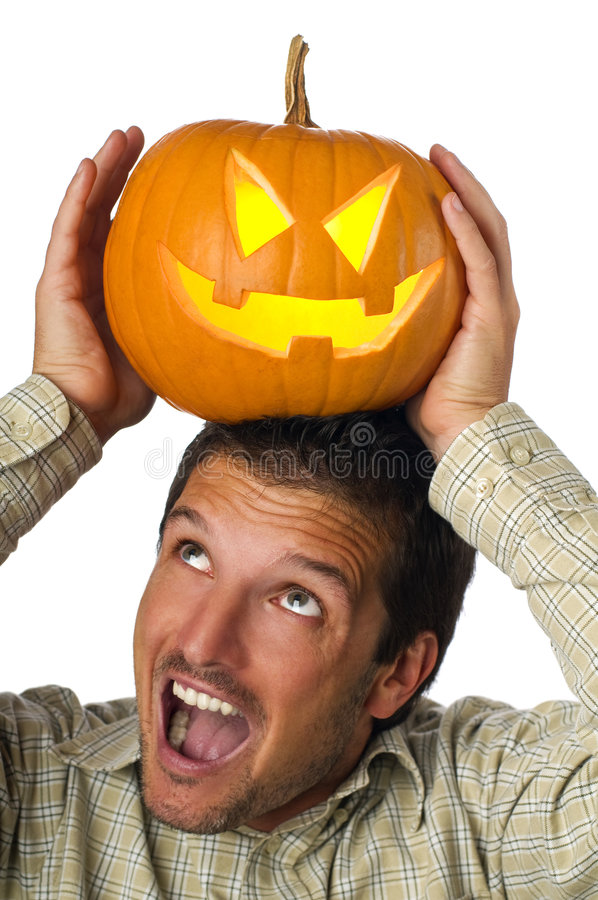 Halloween. Young man holding halloween pumpkin close up stock image