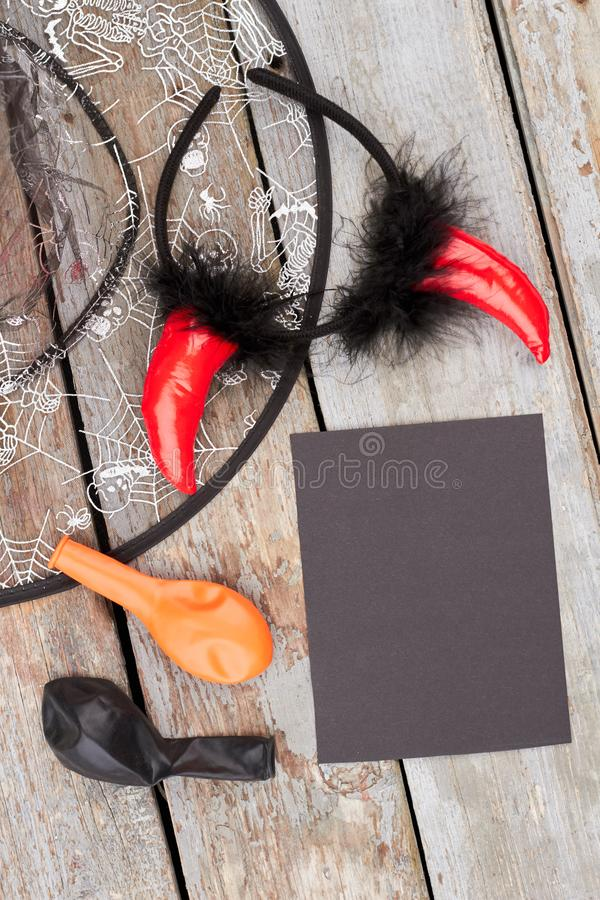 Halloween accessories on wooden background. stock photo