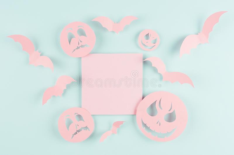 Halloween advertising mock up - pink blank sale card with soar bats and funny scary monsters faces on candy pastel green color. stock image