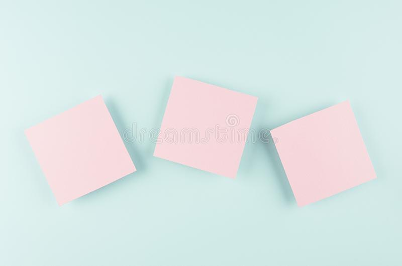 Halloween advertising mock up - three pink blank sale card soar on candy pastel mint blue background. stock image