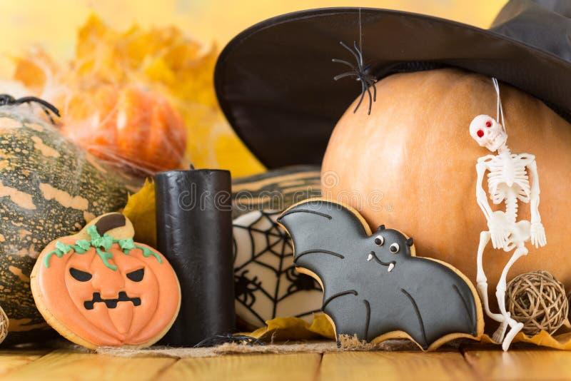 Halloween. Pumpkin, skeleton, gingerbread, spider, black hat stock photography