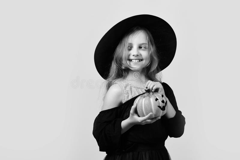 Halloween and autumn holiday concept. Girl with carved orange pumpkin royalty free stock images