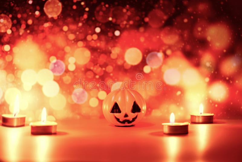 Halloween background candlelight orange decorated holidays festive concept - funny faces jack o lantern pumpkin halloween royalty free stock image