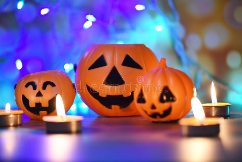 Halloween background candlelight orange decorated holidays festive concept - funny faces jack o lantern pumpkin halloween royalty free stock photos