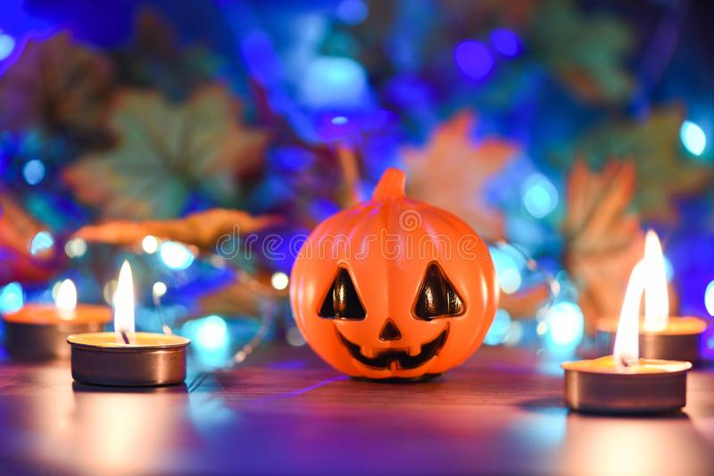 Halloween background candlelight orange decorated holidays festive concept / funny faces jack o lantern pumpkin halloween royalty free stock photos