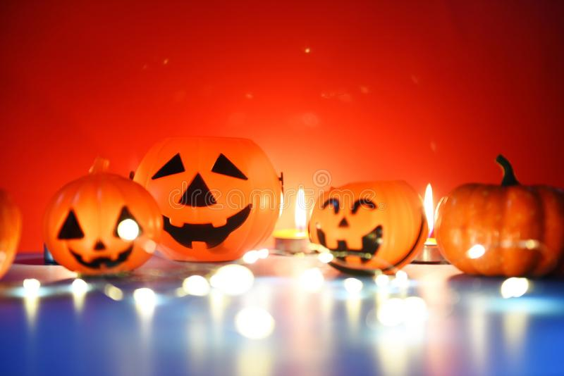 Halloween background candlelight orange decorated holidays festive concept - funny faces jack o lantern pumpkin halloween. Halloween background candlelight stock photography