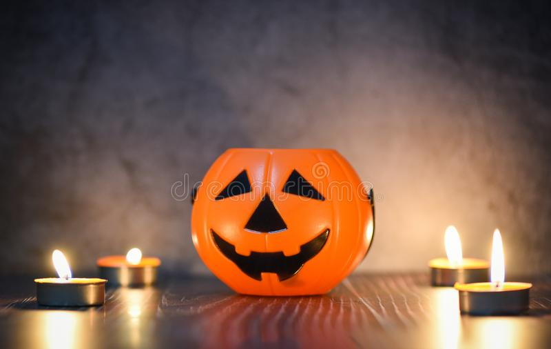 Halloween background candlelight orange decorated holidays festive concept - funny faces jack o lantern pumpkin halloween royalty free stock photography