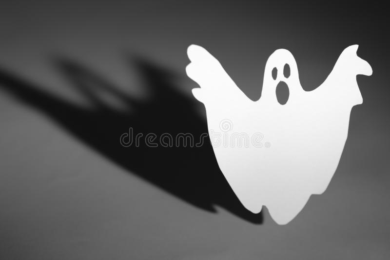 Halloween background concept. Funny ghost doing boo gesture and stock photography