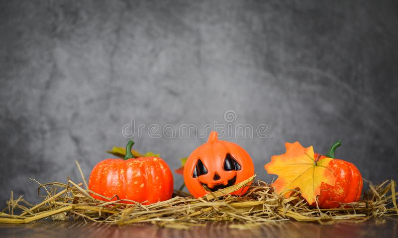 Halloween background decorated holidays festive concept - jack o lantern pumpkin halloween decorations with leaves autumn on straw royalty free stock photo