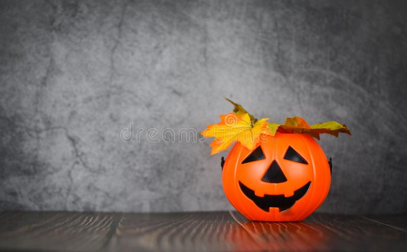 Halloween background decorated holidays festive concept - jack o lantern pumpkin halloween decorations with leaves autumn on dark stock images