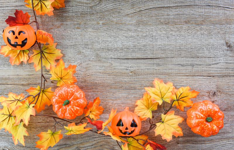 Halloween background with dry leaves autumn on wooden decorated holidays festive concept / jack o lantern pumpkin halloween stock images