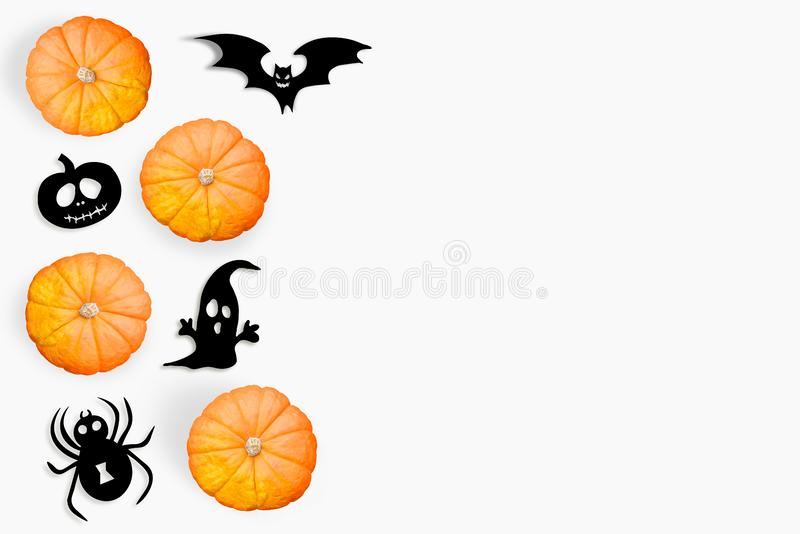 Halloween background. Festive holiday card with orange pumpkins and scary symbols, bat, jack, spider and ghost. Top view stock images