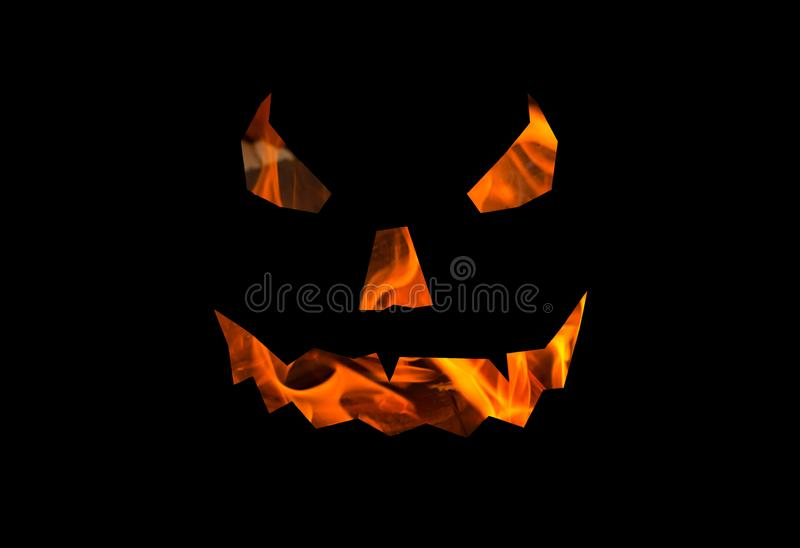 Halloween background lantern jack, terrible face texture of fire on a black base royalty free illustration