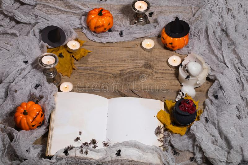 Halloween background. Opened book of bewithcment. royalty free stock photography