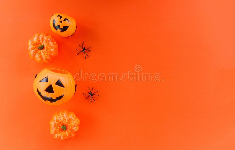 Halloween background orange decorated holidays festive concept - spider and jack o lantern pumpkin halloween decorations for party stock photos