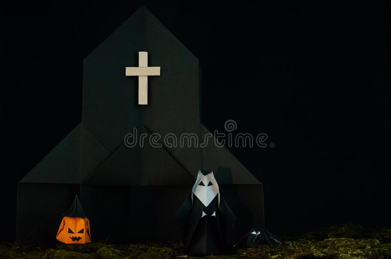 The Halloween background of origami or Paper folding that the nun standing in front of black church with jack-o-lantern and. Spider with messy lawn on black royalty free stock photos