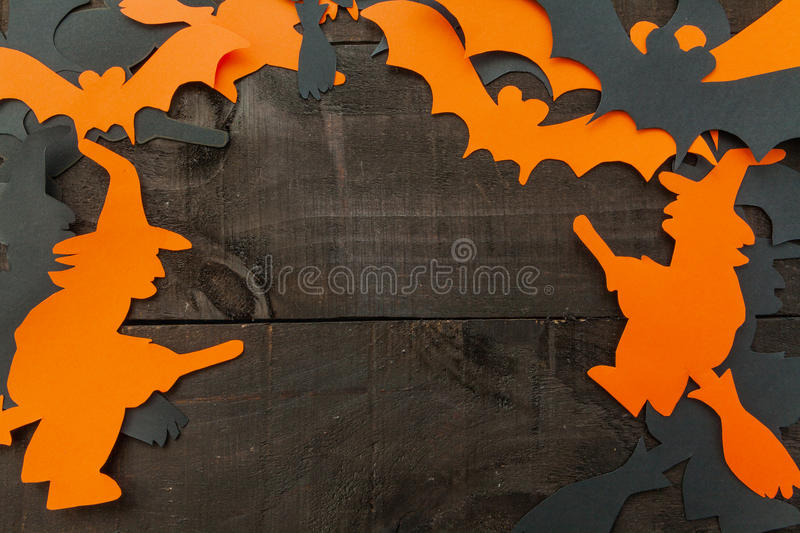 Halloween background. Picture taken from above with halloween elements framing a possible text on wooden background and the colors of red and orange stock photography