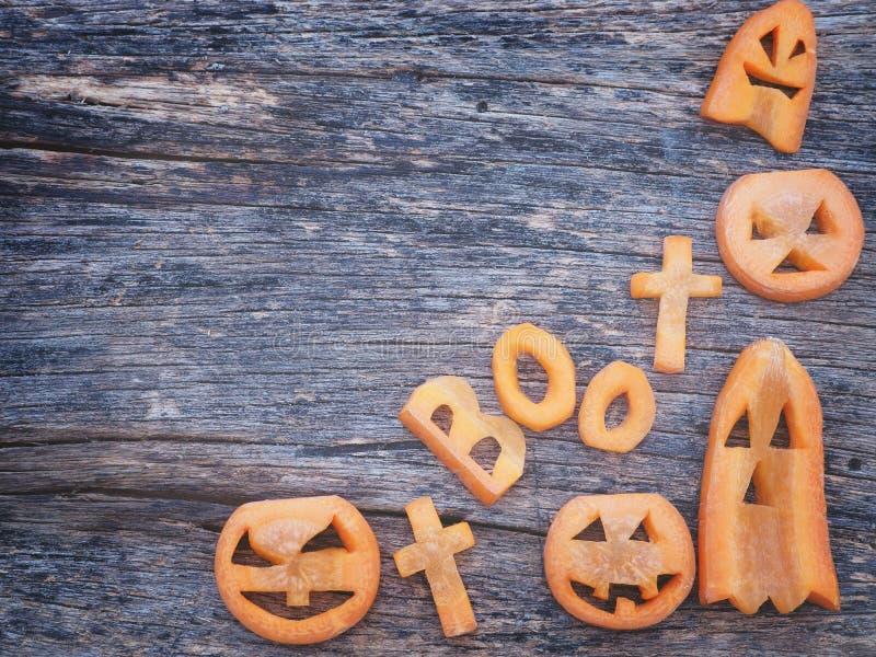 Halloween background.Scarved jack-o-lantern and spooky carrots. Halloween background.Carved jack-o-lantern and spooky carrots royalty free stock image
