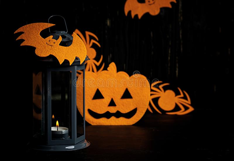 Halloween background with spider, bats, pumpkins and lantern. Halloween holiday background royalty free stock image