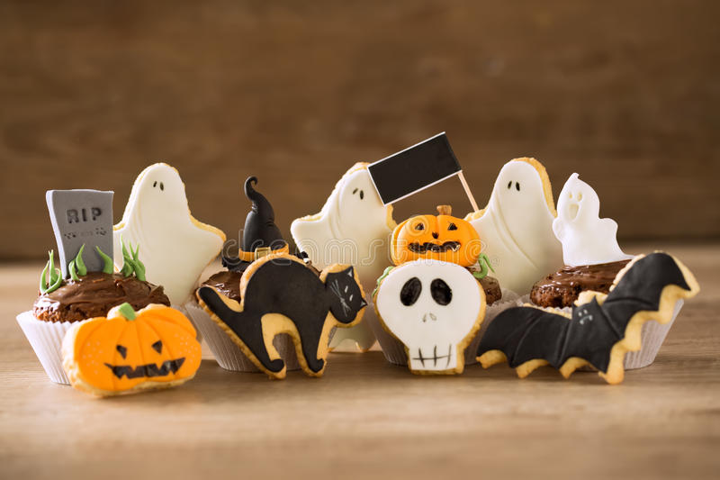 Halloween background. Spooky Halloween cookies and cupcakes background royalty free stock images