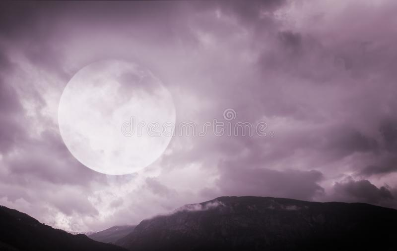 Halloween background. Spooky mountains with full moon. Halloween background. Spooky dark mountains with full moon stock photos