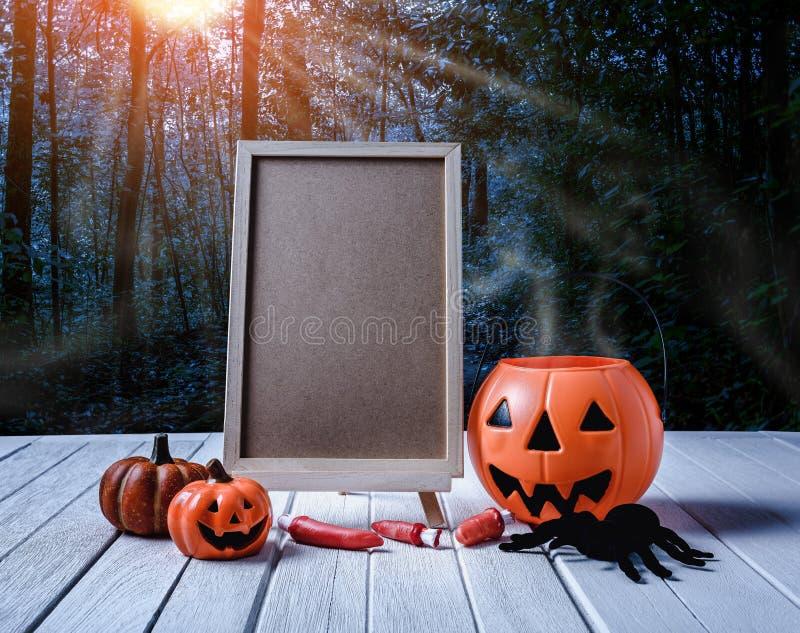 Halloween background. Spooky pumpkin, chalkboard on wooden floor royalty free stock image