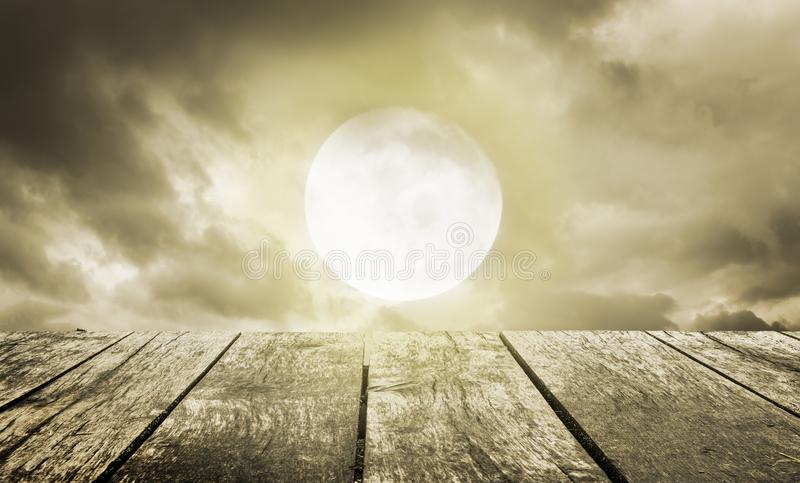 Halloween background. Spooky sky with full moon and wooden table. Halloween background. Spooky dark sky with full moon and wooden table royalty free stock photo