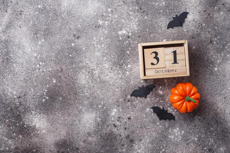 Halloween background with wooden calendar. And bats stock photography