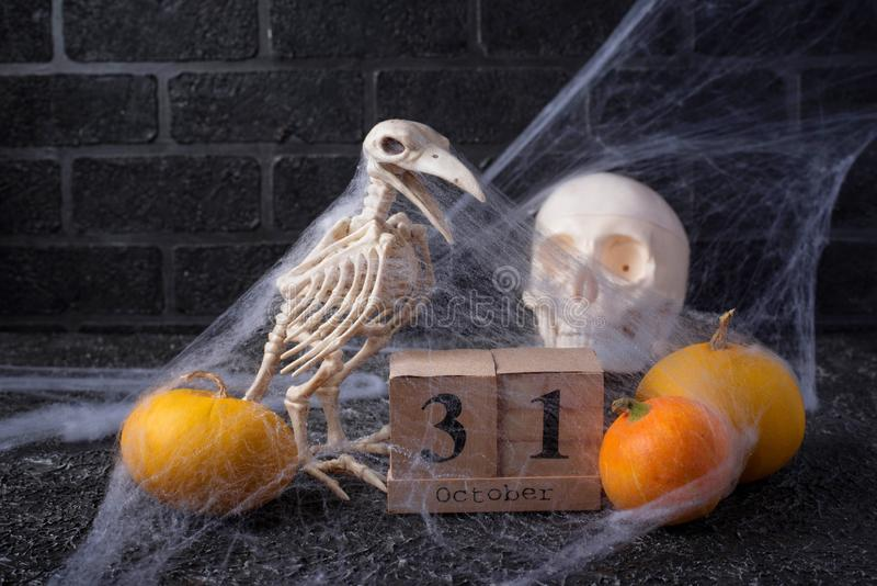 Halloween background with wooden calendar. And bird skeleton royalty free stock images