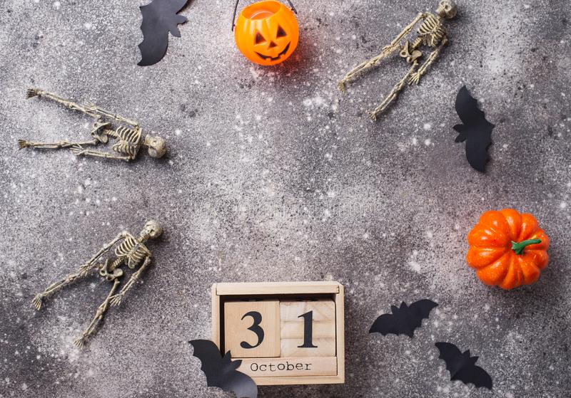 Halloween background with wooden calendar. And bats stock images