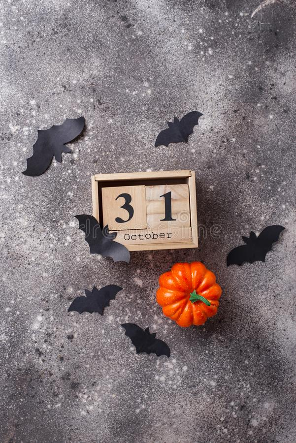 Halloween background with wooden calendar. And bats stock image