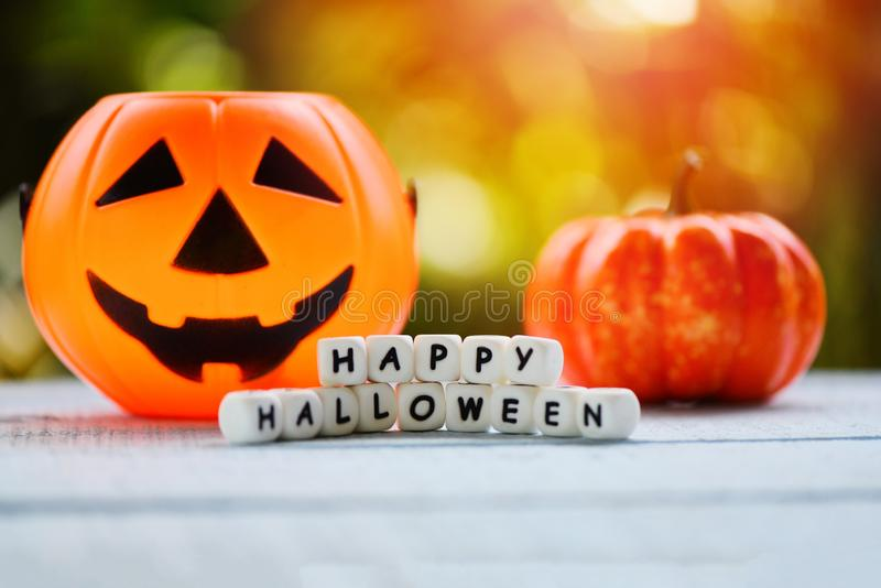Halloween background with word blocks happy halloween decorations and pumpkin jack o lantern funny spooky on wooden table happy royalty free stock photography