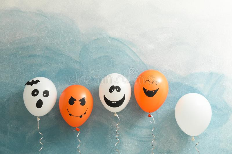 Halloween balloons on color background royalty free stock image