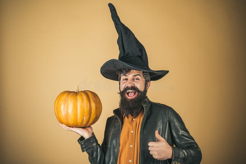 Halloween beaded man hold pumpkin - portrait. Portrait of Handsome man with pumpkin over  background. Halloween. Man posing with pumpkins stock image