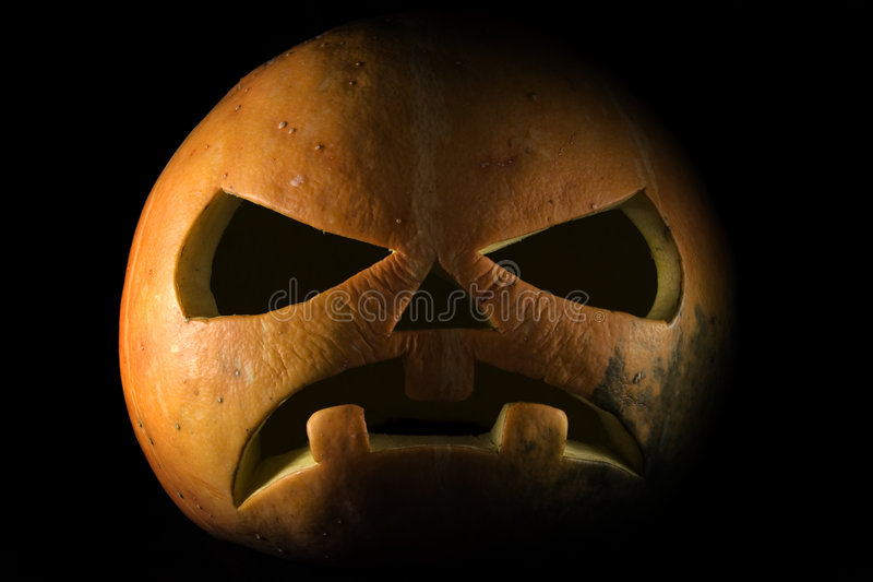 Halloween_black. The large orange pumpkin on a black background stock image