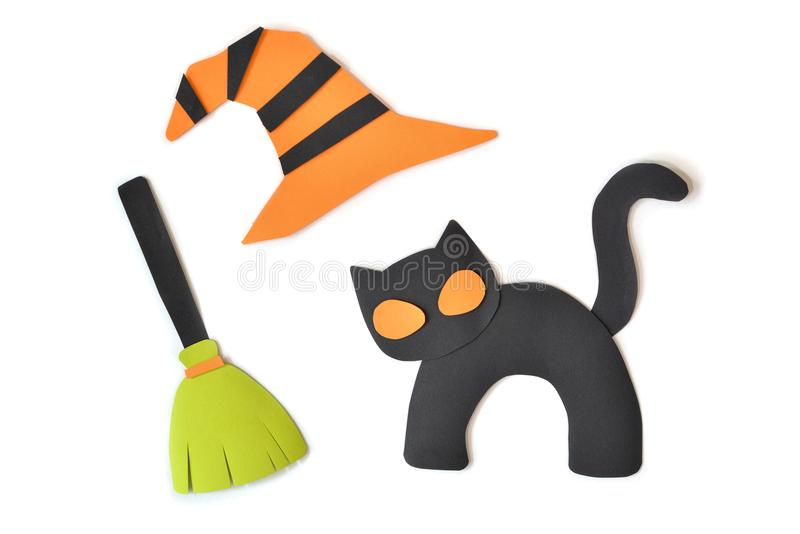 Halloween black cat witch broom and hat on white background stock photos