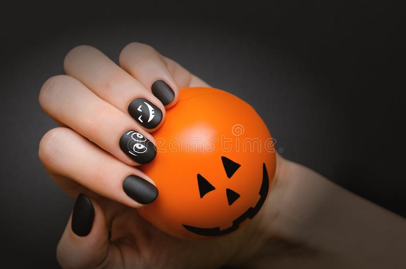 Halloween black Nail art design. royalty free stock image