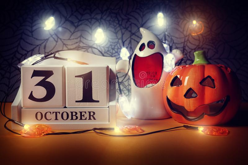 Halloween calendar. Date 31st October with pumpkin and ghost royalty free stock photography